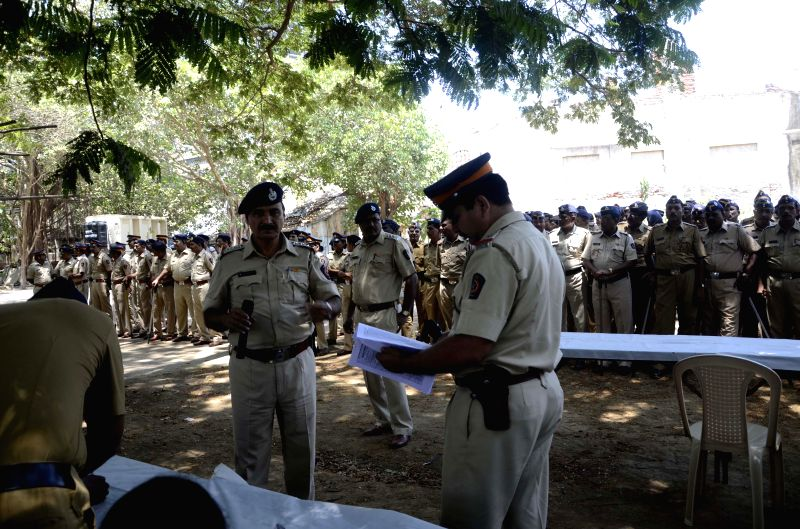 Police personnel deployed at D G Ruparel College where counting centre for 2014 Lok Sabha polls has been setup in Mumbai on May 15, 2014.