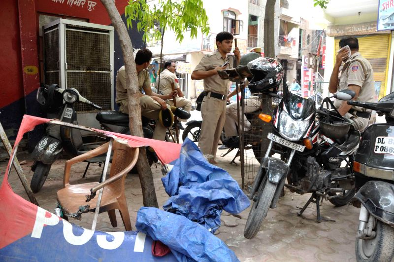 Police personnel deployed near Mukherjee Nagar of New Delhi after civil service aspirants allegedly went on rampage to press for scraping of Civil Services Aptitude Test (CSAT) in Mukherjee Nagar, ...