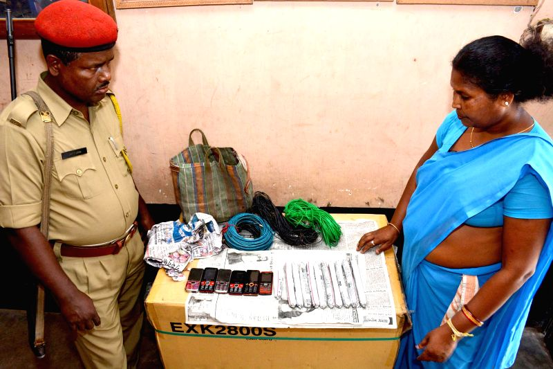 Police personnel display gelatin sticks, mobile phones and coils of Cordex wire recovered from the five persons arrested in Guwahati on May 11, 2014.