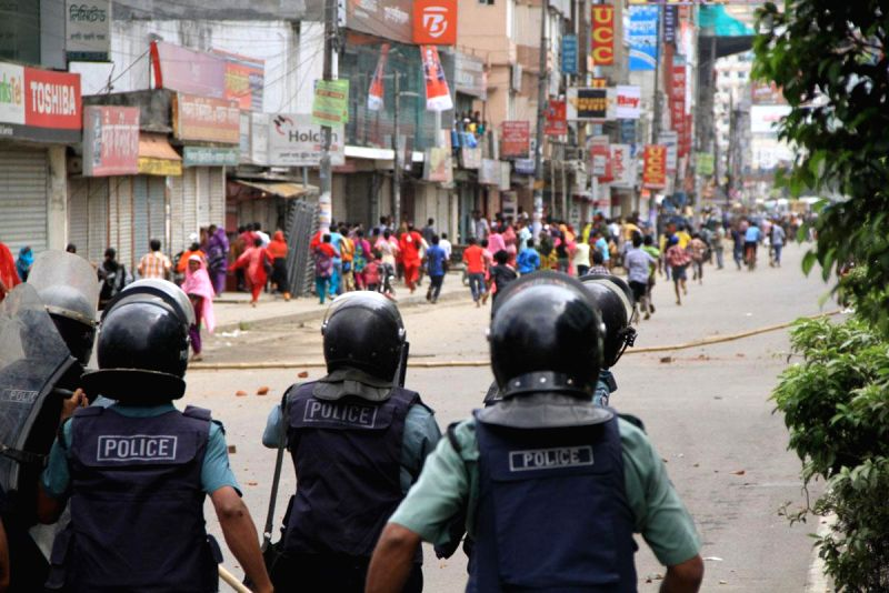 Police personnel in action as Tuba Group garment workers clash with police during an eviction drive to remove  protesters from a Badda factory where they were holding a hunger strike in Dhaka, ...