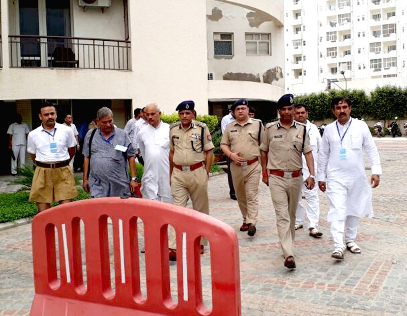 Police personnel inspect the security arrangements on the eve of three-day meeting of the All India coordination committee of the RSS at Keshav Dham in Vrindavan on Aug 31, 2017.