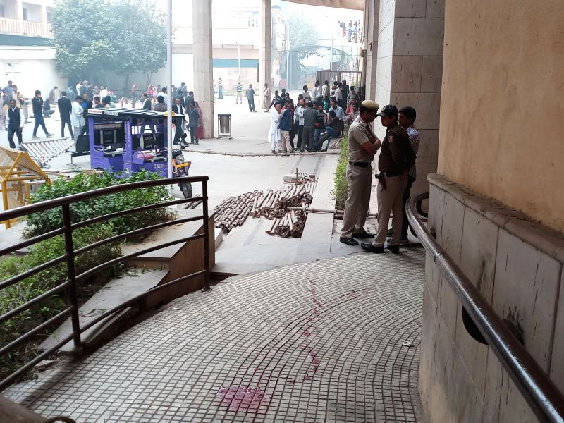 Police personnel outside Rohini court after an undertrial prisoner Vinod alias Balle was shot dead when he was being taken back from the Rohini court in New Delhi on Nov 13, 2017. ... - Abdul Khan