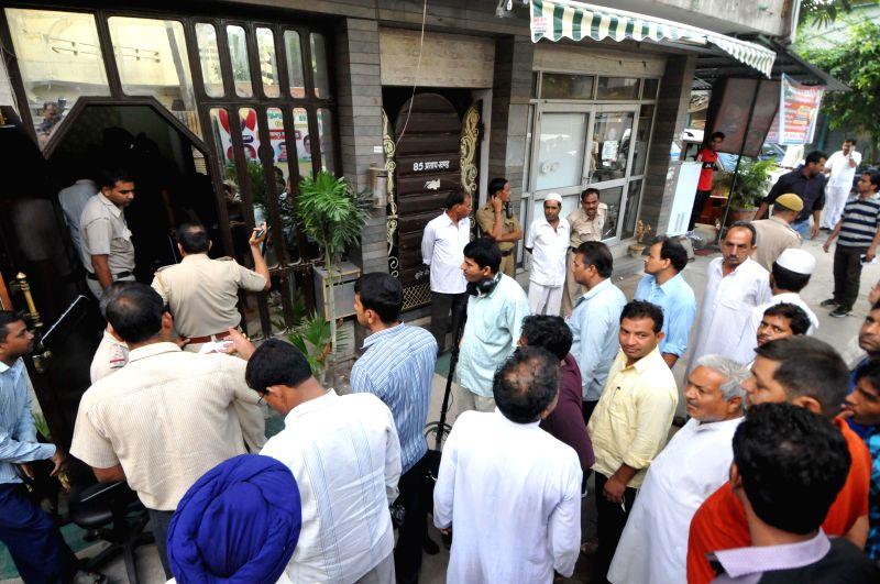 Police personnel outside the house of Delhi BJP legislator Jitender Singh Shunty, who was attacked outside his Shahdara home in New Delhi on Sept 3, 2014. - Jitender Singh Shunty