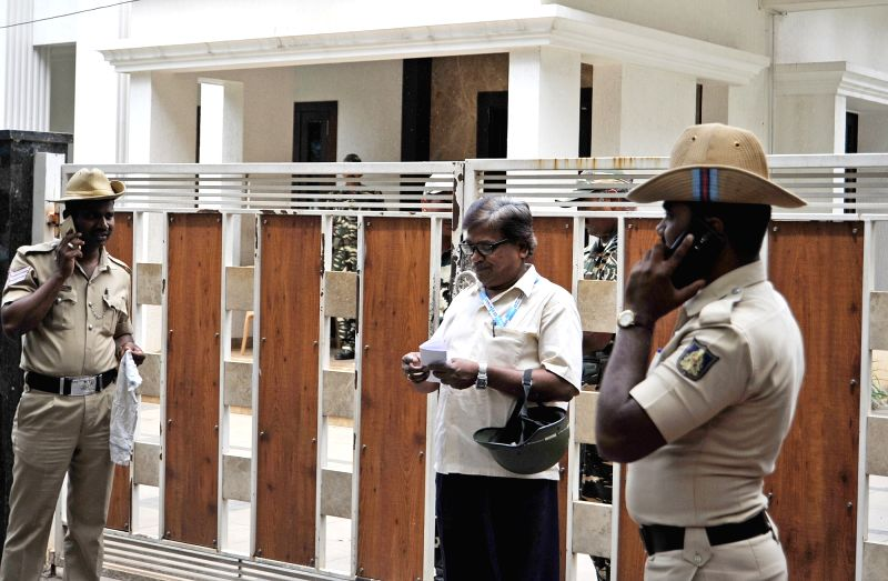 Police personnel outside the residence of Karnataka Energy Minister DK Shivakumar during the Income Tax department raids in Bengaluru on Aug 4, 2017. - D