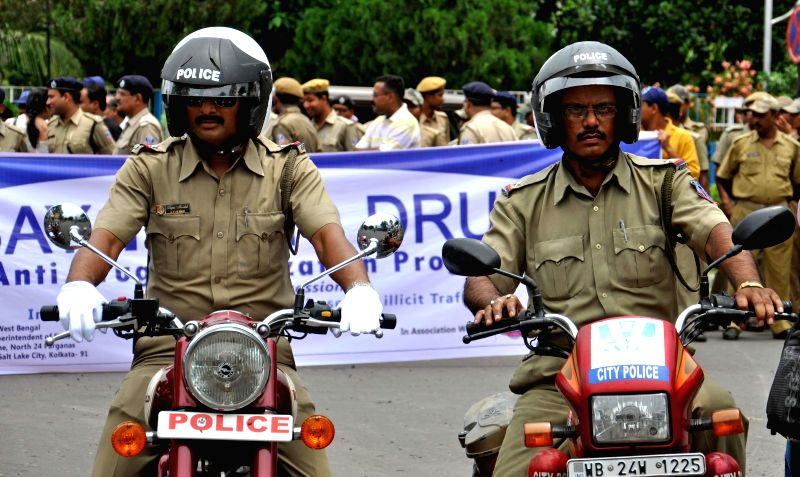 Police personnel participate in a motorcycle rally organised on United Nations' International Day Against Drug Abuse and Illicit Trafficking in Kolkata on June 26, 2014.
