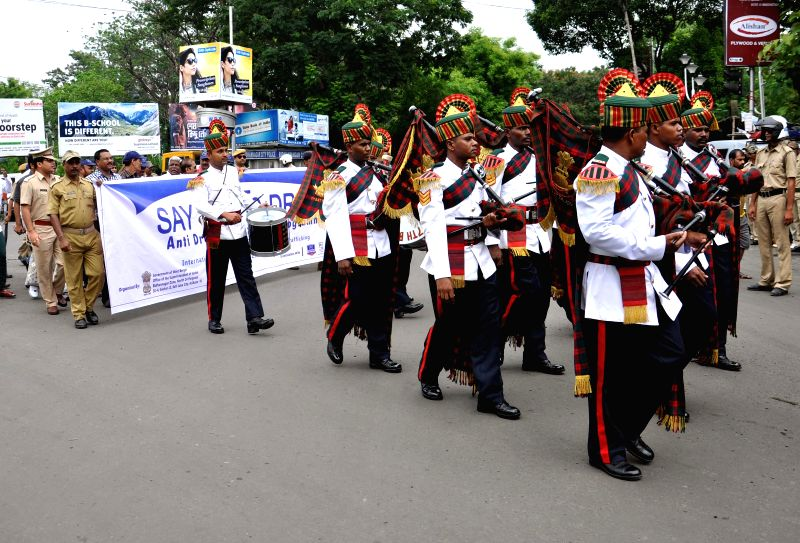 Police personnel participate in a rally organised on United Nations' International Day Against Drug Abuse and Illicit Trafficking in Kolkata on June 26, 2014.
