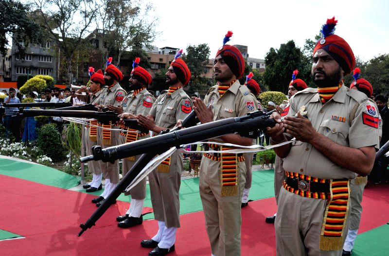 Police personnel pay tribute to martyrs during a ceremony organised on the eve of Baisakhi in Amritsar on April 13, 2014.