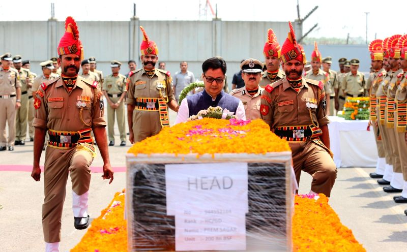 Police personnel pay tributes to the martyred BSF Head Constable Prem Sagar in New Delhi on May 2, 2017.