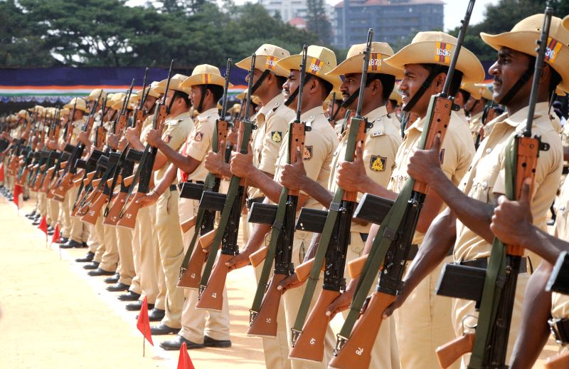 Police personnel rehearse for Independence Day parade at Manekshaw Parade Grounds in Bangalore on Aug 11, 2014.
