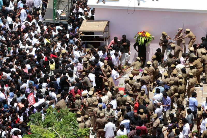 Police personnel resort to baton-charge to disperse a large crowd of supporters forcefully trying to enter Rajaji Hall where the body of the late DMK President M. Karunanidhi is lying in ...