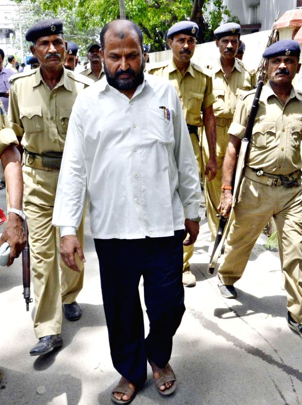 Police personnel take Shamse-e-Alam an accused in the  28th Dec. 2002 Ashiyana fake encounter case after he was awarded death sentence by a CBI court in Patna on June 24, 2014.