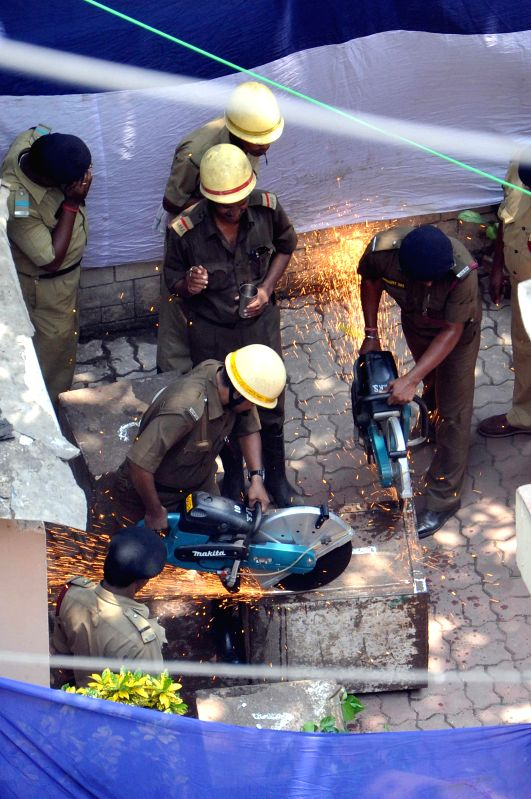 Police personnel trying to open three iron chests which are suspected to be 300 years old, found at a under construction site in Kolkata on June 16, 2014.