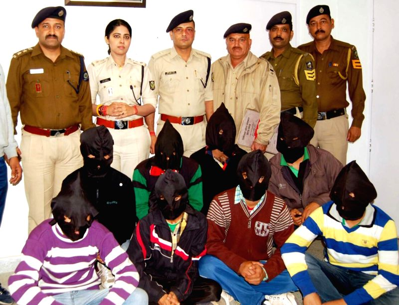 Police present before press a gang of cattle smugglers at Sirmaur district of Himachal on Oct 29, 2015.