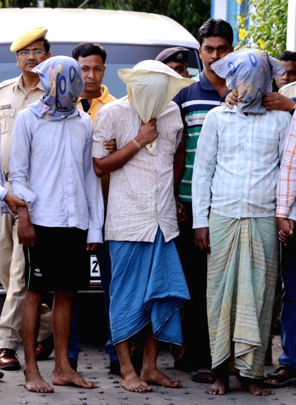 Police present before press three persons allegedly involved in rape of a 25 year old woman in Kolkata's Salt Lake; on May 31, 2016.
