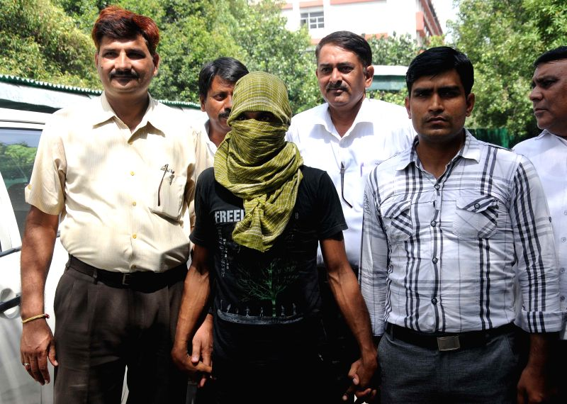 Police presents Mazher alias Shekher, who has been arrested in connection with Karawal Nagar double murder case, at Police Headquarters in New Delhi on Aug 21, 2014.
