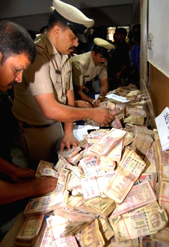 Police seize demonetised notes with face value of two crores and 25 lakhs in Bengaluru, on June 6, 2017.