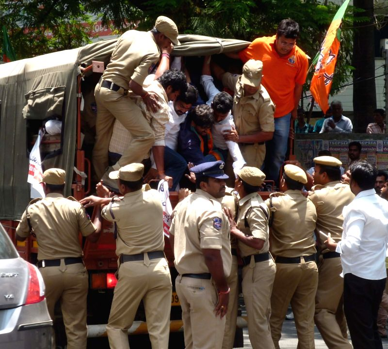 Police take away BJP workers protesting against the draft legislation that seeks to increase quota for the Muslims to 12 per cent in Hyderabad on April 17, 2017. The bill also has ...