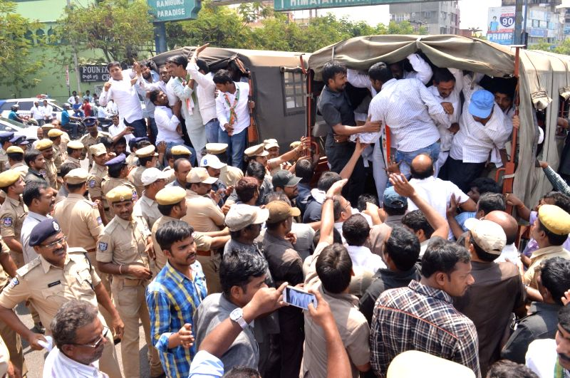 Police take away Congress workers staging a protest against the shifting of dharna chowk from Indira Park to a location on the outskirts of the Hyderabad on April 17, 2017.