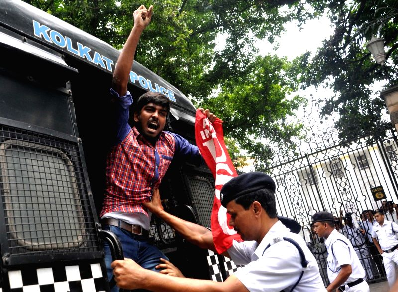 Police take away DSO activists staging a demonstration to press for re-introduction of pass-fail system up to class VII in front West Bengal Assembly in Kolkata on May 29, 2017.