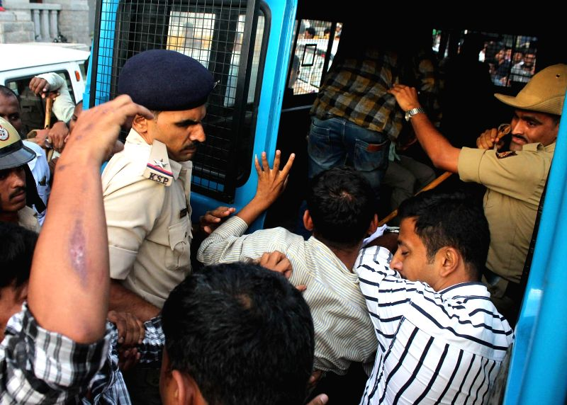 Police take away SFI activists participating in pro-beef protest at Town Hall in Bengaluru on May 29, 2017.