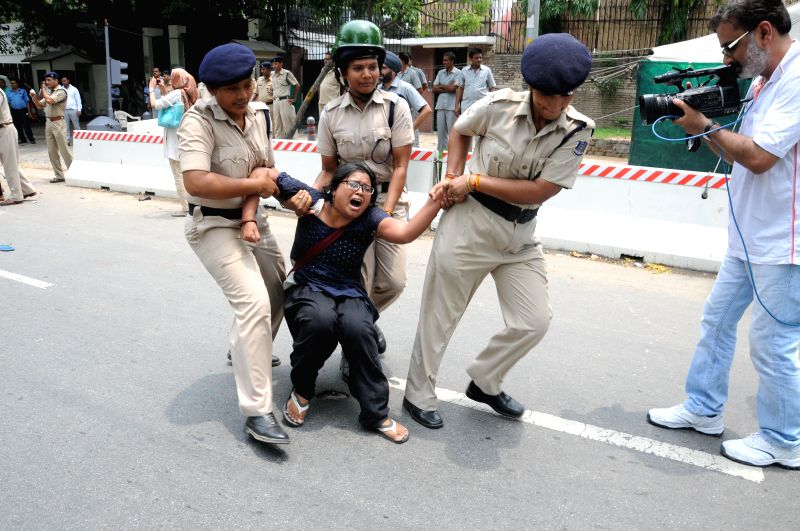 Police takes away a JNU student demonstrating against Israeli attacks on Gaza in front of Israeli Embassy in New Delhi on July 14, 2014.
