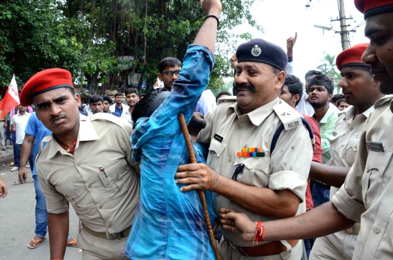 Police takes away an All India Students' Federation (AISF) activist staging a demonstration against the alleged discrepancies in the class 12 results declared by Bihar School Examination ...
