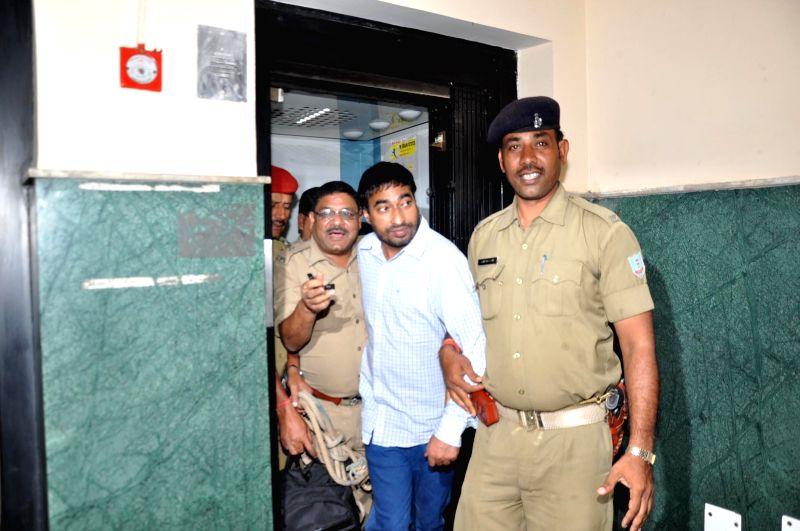 Police takes away Ranjit Kohli alias Rakibul Hassan, who married shooter Tara Shadeo pretending to be a Hindu and allegedly forced her to embrace Islam later, in Ranchi on Aug 31, 2014. Kohli is ... - Rakibul Hassan
