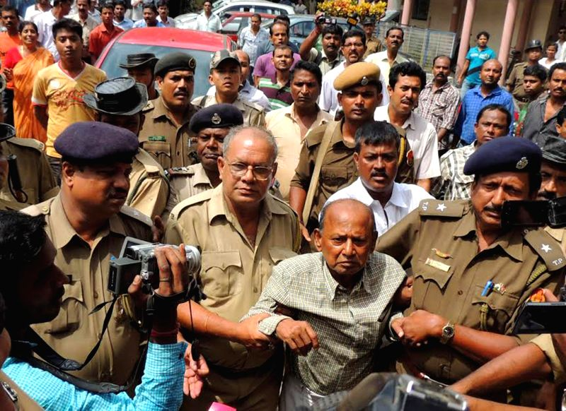 Police takes out Sushil Choudhury, editor-cum-owner of a Tripura newspaper, after a court found him guilty in a year-old triple murder case guilty in Agartala July 14, 2014. Three of his employees ... - Sushil Choudhury