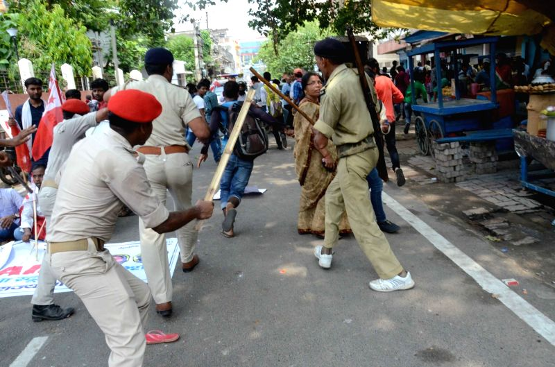 Police thwarts the demonstration by activists of All India Students' Federation (AISF) against the alleged discrepancies in the class 12 results declared by Bihar School Examination Board ...