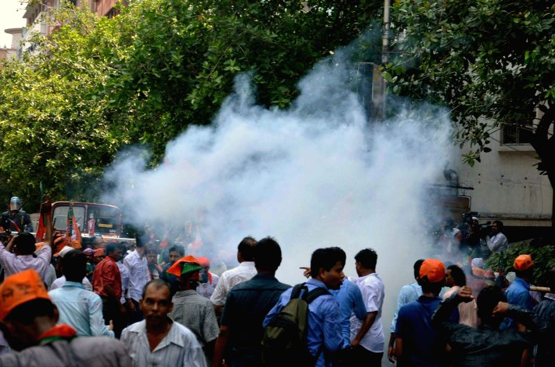 Police use tear gas to disperse BJP workers during a protest in Kolkata on May 25, 2017.