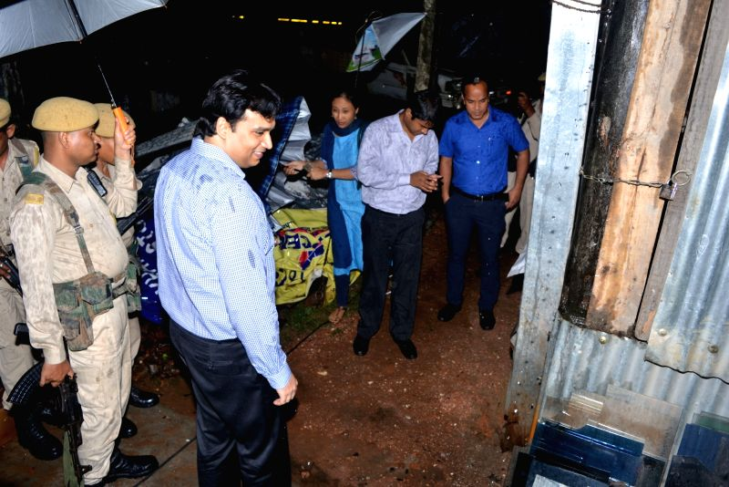 Policemen carry out investigations at the site where a bomb exploded in Nagaon of Assam, on May 17, 2016.