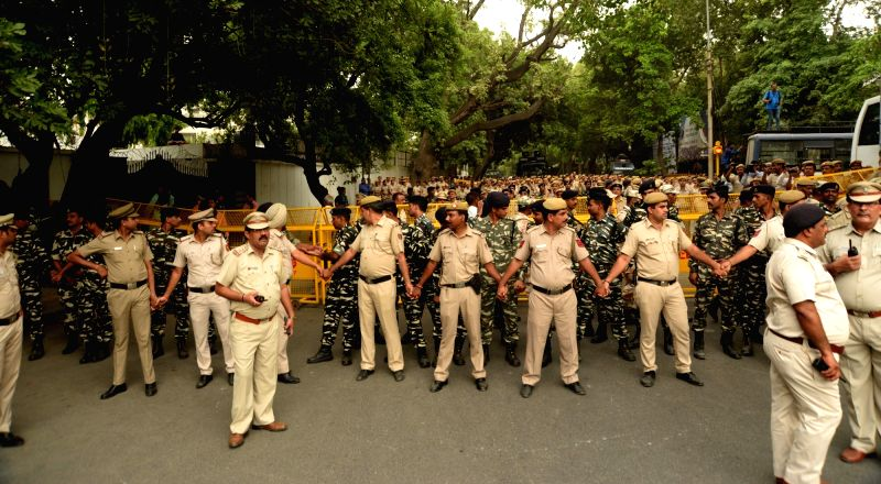 Policemen deployed to contain Aam Aadmi Party (AAP) workers' protest march towards Raj Niwas in New Delhi, on June 13, 2018.