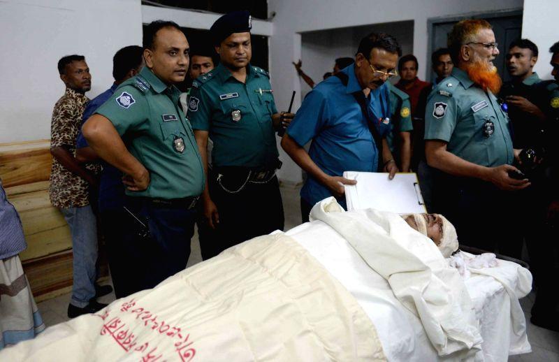 "Policemen inspect the body of secular blogger Faisal Arefin Dipan at Dhaka Medical College in Dhaka, Bangladesh, Oct. 31, 2015. ""Ansar-Al-Islam,"" which ... - Avijit Roy and Ronovipon Basu"