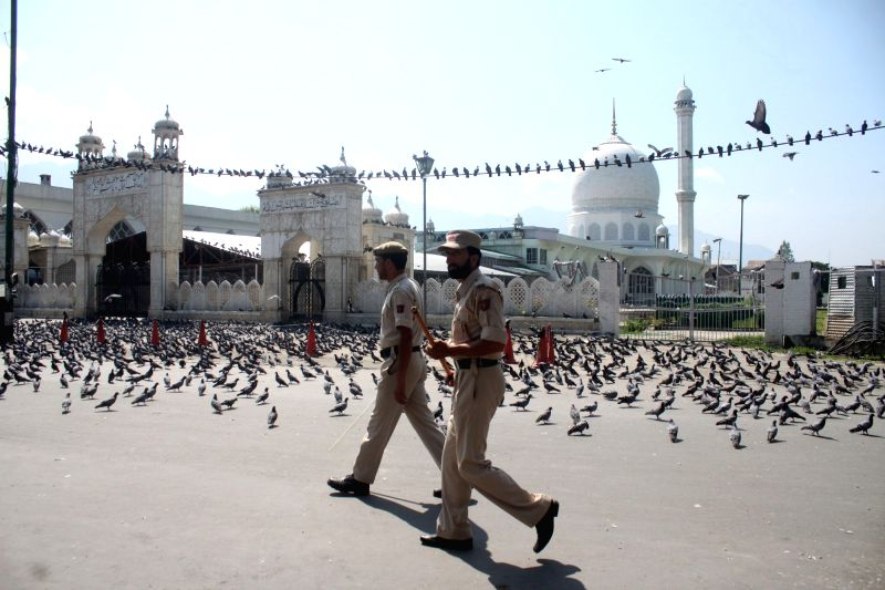 Policemen on patrol duty near Dargah Hazratbal, where people could not reach for congregational Friday prayers as authorities imposed  curfew in Kashmir valley; in Srinagar on Aug 5, 2016.