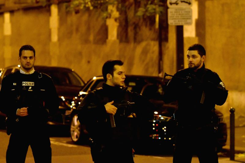 :Policemen patrol near an attacked restaurant in Paris, France, Nov. 13, 2015. Over 100 people have been reportedly killed and many more wounded in a series of what ... - Narendra Modi