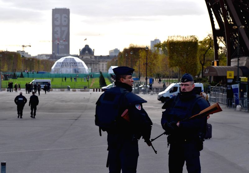 Policemen patrol near the Tour Eiffel in Paris, France, Nov. 14, 2015. Paris strengthened the security at tourism sites after deadly attacks unfolded in Paris on ...