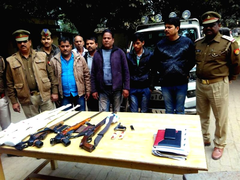Policemen present before press weapons recovered from Cholapur village near Varanasi on Jan 11, 2017.