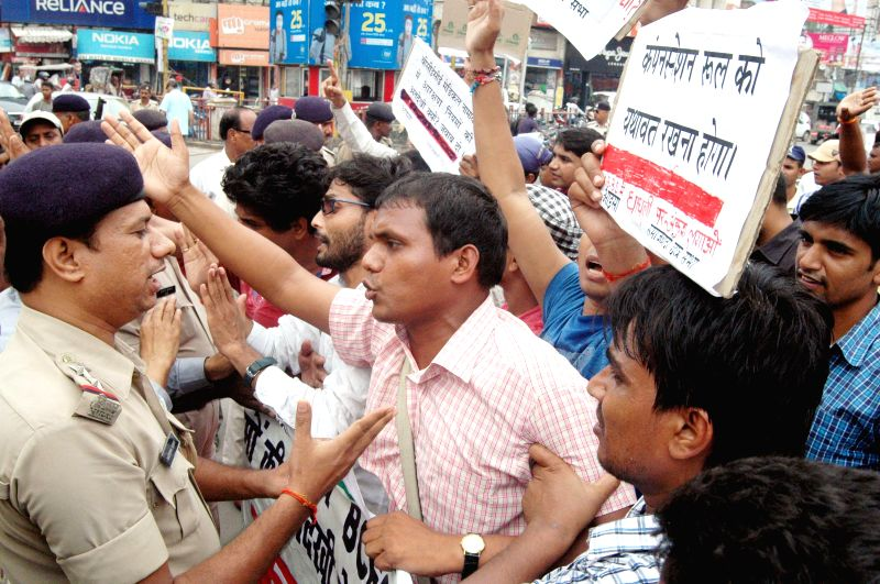 Policemen stop AISA activists from carrying on with their protest rally in Patna on Aug 27, 2014.
