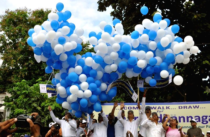 Political leaders, artists, sports persons and other activists take part in a rally for support of `Smart Bidhannagar` in Kolkata on Oct 31, 2015.
