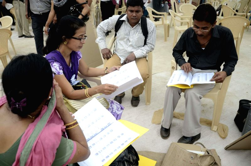 Polling personnel ahead of leaving for their respective polling booths at a polling station ahead of the 6th phase of 2014 Lok Sabha Elections in Mumbai on April 23, 2014.