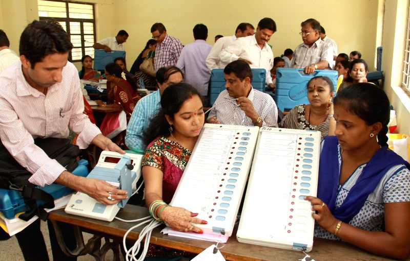 Polling personnel at a polling station ahead of the fifth phase of 2014 Lok Sabha Election in Bangalore on April 16, 2014.