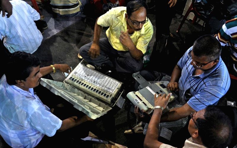 Polling personnel at an EVM and election material distribution centre ahead of the 7th phase of 2014 Lok Sabha Elections in Howrah on April 29, 2014.