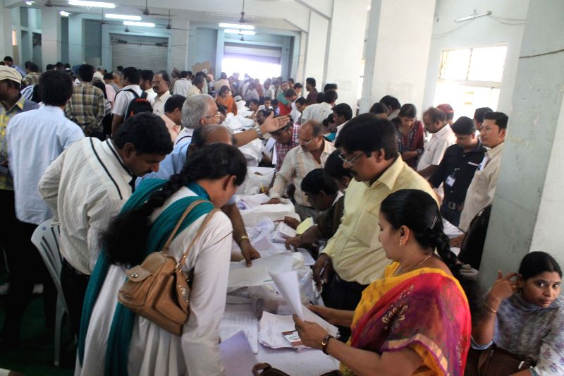 Polling personnel at an EVM and election material distribution centre ahead of the 7th phase of 2014 Lok Sabha Elections in Hyderabad on April 29, 2014.