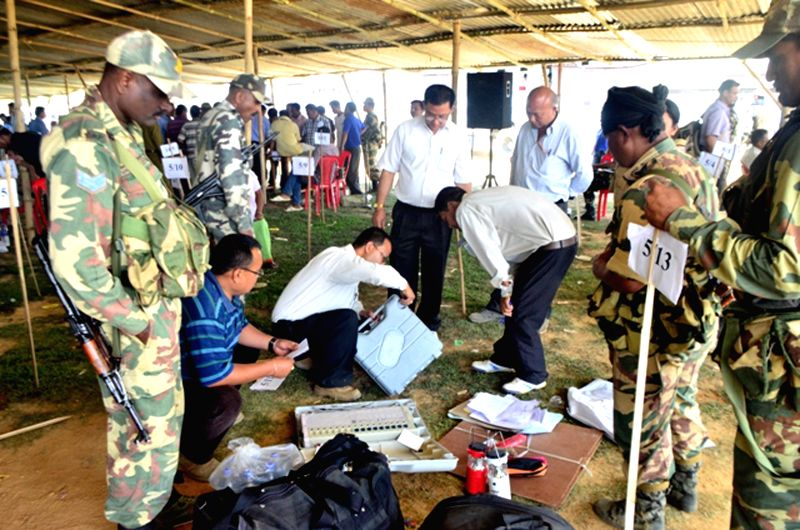 Polling personnel inspect Electronic Voting Machines (EVMs) at a polling station ahead of the fifth phase of 2014 Lok Sabha Election in Imphal on April 16, 2014.