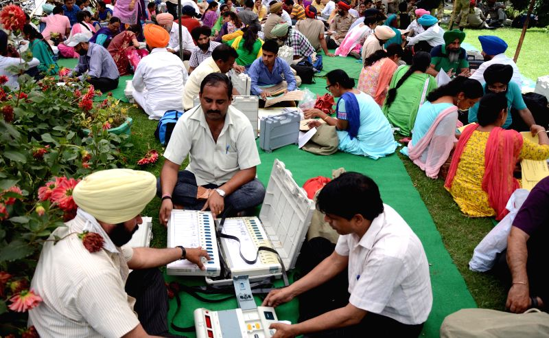 Polling personnel inspect Electronic Voting Machines (EVMs) at an EVM and election material distribution centre ahead of the 7th phase of 2014 Lok Sabha Elections in Amritsar  on April 29, 2014.