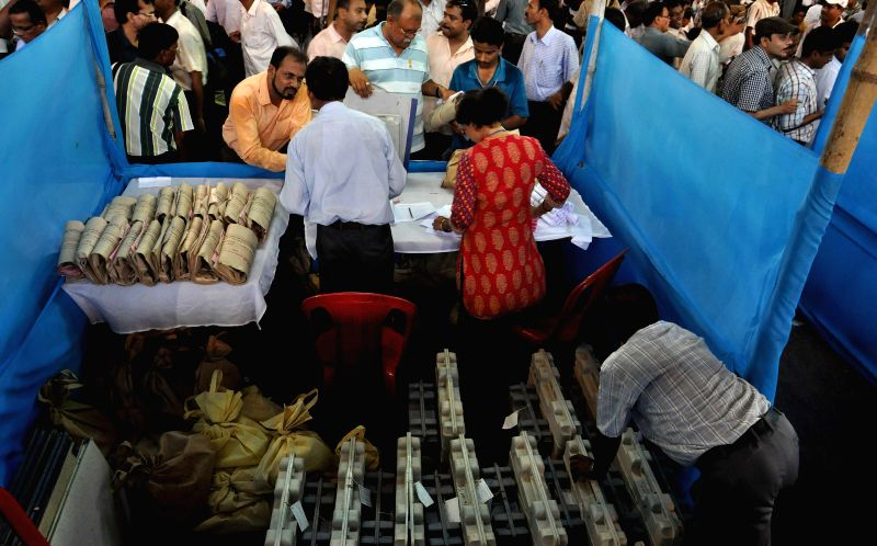 Polling personnel inspect Electronic Voting Machines (EVMs) at an EVM and election material distribution centre ahead of the 7th phase of 2014 Lok Sabha Elections in Howrah on April 29, 2014.