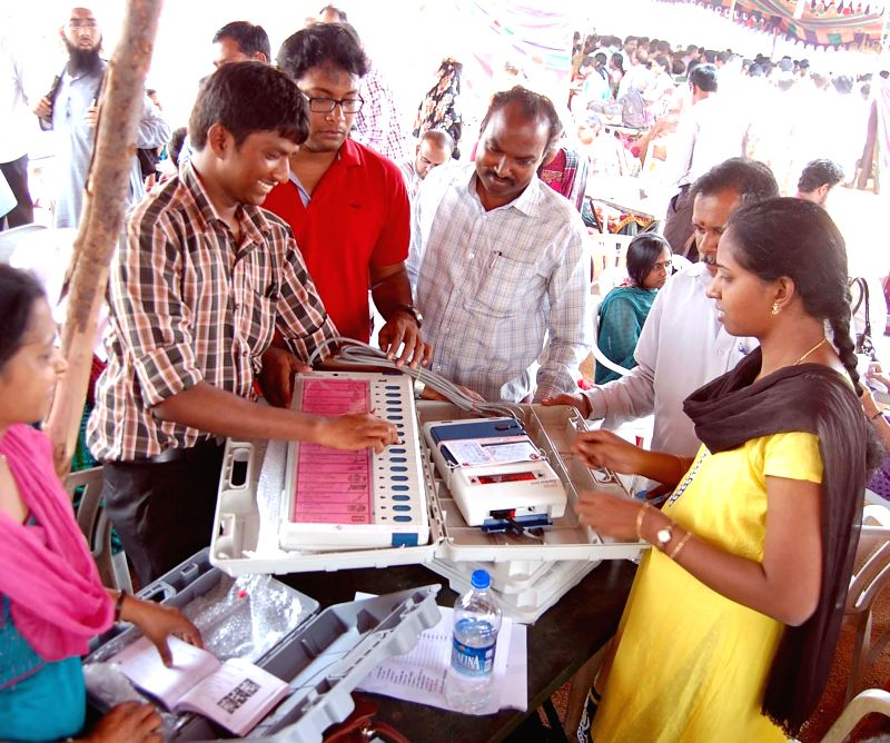 Polling personnel inspect Electronic Voting Machines (EVMs) at an EVM and election material distribution centre ahead of the 7th phase of 2014 Lok Sabha Elections in Hyderabad on April 29, 2014.