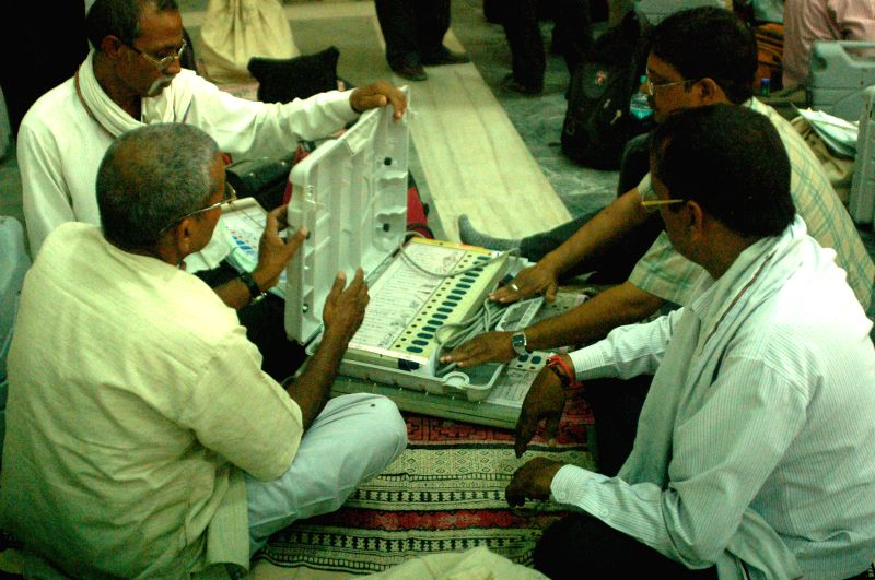 Polling personnel inspect Electronic Voting Machines (EVMs) at an EVM and election material distribution centre ahead of 9th phase of 2014 Lok Sabha Elections in Varanasi on May 11, 2014.