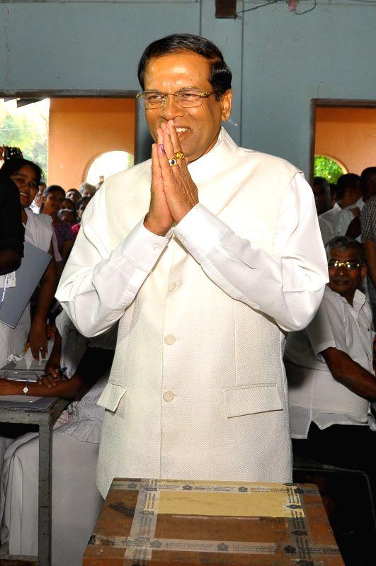 Sri Lanka's main opposition presidential candidate Maithripala Sirisena casts his vote at a polling station in Polonnaruwa, Sri Lanka, Jan. 8, 2015. Sri Lanka ...