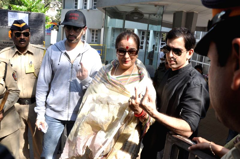 Poonam Sinha wife of actor and politician Shatrughan Sinha with her sons Luv Sinha and Kush Sinha shows their fore fingers marked with phosphorous ink after casting their vote at a polling booth ... - Poonam Sinha, Shatrughan Sinha, Luv Sinha and Kush Sinha